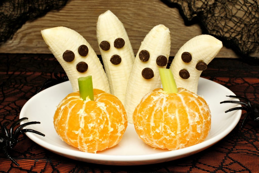 Halloween treats with fruit bananas and oranges healthy fall snacks